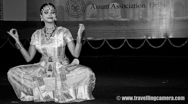 "Sattriya Dance Performance during Rongali Bihu Festival @ Indira Gandhi national Center of Arts (organized by Assam Association, Delhi on 24th April 2011) : Posted by VJ SHARMA on www.travellingcamera.com : Sattriya Dance performances is one of the main highlight of Rogali Bihu Festival at IGNCA, Delhi ! And this performance was full of expressions and it seems these songs were telling some story which dancer was enacting through her steps !!!  Let's have a look at some of the photographs from Sattriya performance on 24th April, 2011 with relevant information about this particular form of Indian Classical Dance !!!Sattriya Nritya is one among eight principal classical Indian dance traditions. Whereas some of the other traditions have been revived in the recent past, Sattriya has remained a living tradition since its creation by the Assamese Vaishnav saint Srimanta Sankardeva, in 15th century AssamSankardeva created Sattriya Nritya as an accompaniment to the Ankiya Naat (a form of Assamese one-act plays devisdby him), which were usually performed in the sattras, as Assam's monasteries are called. As the tradition developed and grew within the sattras, the dance form came to be called Sattriya Nritya.The name 'Sattriya' has been derived from the word 'Sattra' which are religious Institutes set up by the Vishnava Saint Shrimanta Shankardev for preserving and propagation of tradition, culture and religion. It was coined centuries after and represents all that the Saint had created, which brought about a Socio-cultural Renaissance in the Assam Valley of INDIA !!!The Sattra style was evolved when Shankaradeva, a great artist and musician in himself composed 'Ankiya Bhaona' or 'Ankiya-Nat' (dance-dramas), devotional music- 'Borgeet', and the four sacred texts - ""Kirtan', 'Dasam' 'Ghosa', 'Ratnavali' (the last two composed by Madhavdev). A School of Philosophical Learning emerged and a deeper understanding of life through the simple path of devotion brought one and all to the fold...Actually Sattriya dance of Assam is aclassical form of dance which is highly devotional in character with the spiritual aspect being predominant all through !!!This Dance form of Sattriya is like many of the other Classical Dance forms of India which has been extracted from a larger body of theatrical practices that constitute the Ankiya Bhaona form. References of this dance form can be found in the ancient Indian classical texts like the Natyashastra, the Kalikapurana, the Yoginitantra, and the Abhinayadarpana apart from many sculptures, and historical relicsThe musical Instruments that accompany a performance are the khols or the drums, the taals or the cymbals, the flute and the violin. Even though Sattriya dance is performed by bhokots or the male monks traditionally in monasteries...The popular forms of the Sattriya dance are Apsara Nritya, Behar Nritya, Chali Nritya, Dasavatara Nritya, Gosai Prabesh,  Nadu Bhangi, Manchok Nritya, Bar prabesha, Gopi Pravesha, Rasa Nritya, Rajaghariya Chali Nritya, and Sutradhara.While I was searching throuh all relevant information about this particular form of Indian Classical dance, I found a link where I saw the same artis.. Please have a look and she really looks the same. Isn't it? - http://www.mridusattriya.com/satt_dance.htmlThe Sattriya dance can be classified into two styles namely Paurashik Bhangi that is Tandav or masculine style and Shtri bhangi which is Lasya or feminine style !!!This was one of the interesting performance of the evening at Rogali Bihu Festival although colorful lighting spoiled my lot of photographs... I will be sharing some colorful shots of Sattriya Dance soon !!!Now I know another Indian Classical Dance form and loved the expressions of performer here !!!"