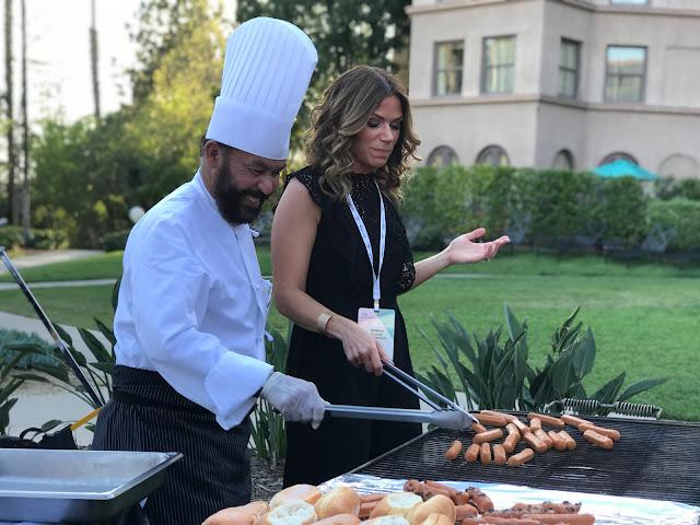 Kristina Kuzmic looking gorgeous and cooking hot dogs