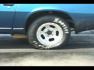Why rear tire is bigger than front tire for drag race ?