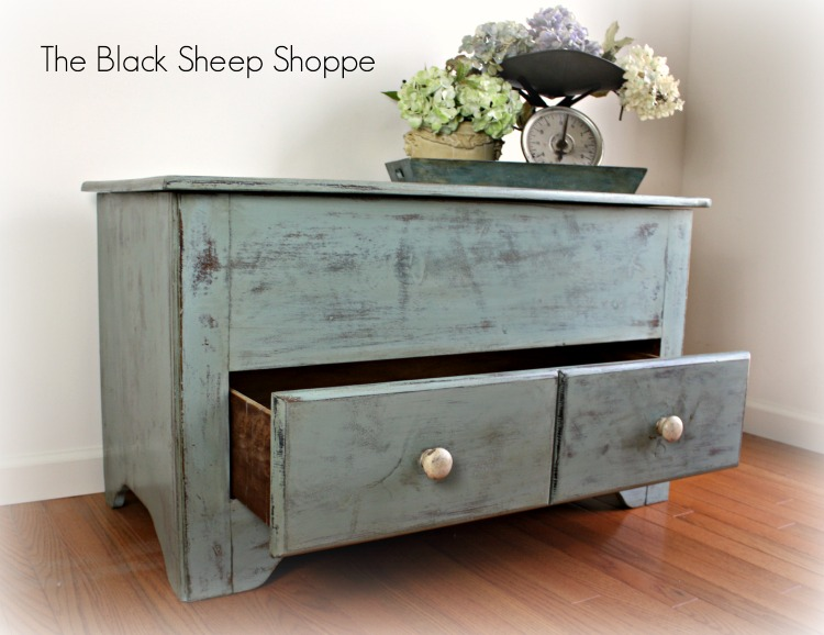 The blanket chest offers plenty of storage. Painted in a rustic finish with Duck Egg blue.