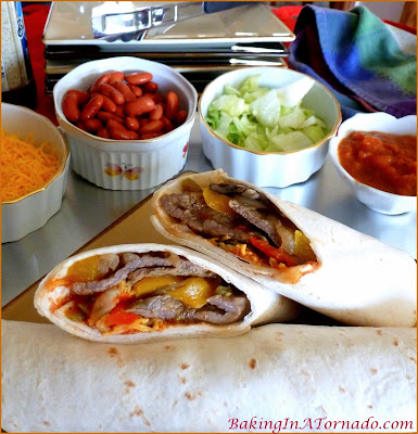 Crockpot Beef Soft Tacos, cook the meat and vegetables in the crockpot with seasonings, then at dinnertime everyone can customize with their favorite toppings | Recipe developed by www.BakingInATornado.com | #recipe #crockpot #slowcooker #dinner