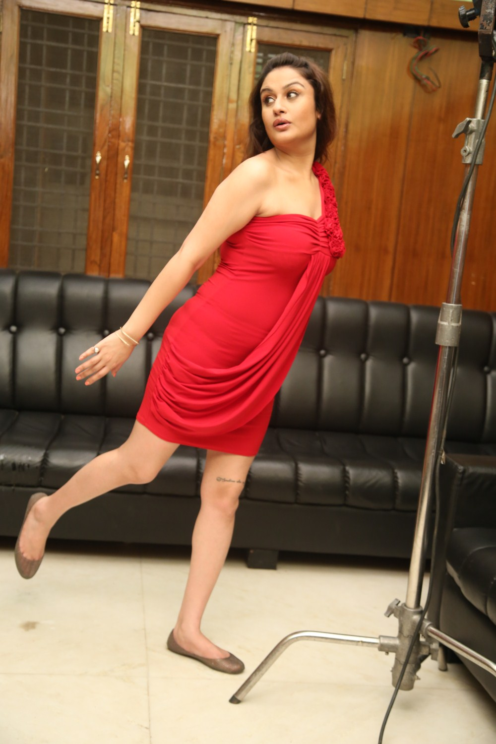 Majestic Sonia agarwal hot photoshoot in red short dress