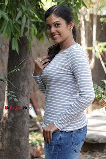 Tamil Actress Chandini Tamilarasan Latest Pos in Ripped Jeansat Ennodu Vilayadu Press Meet  0043.jpg