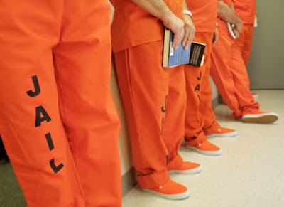 PRISON-INMATES-ORANGE-facebook-1024x678-