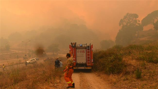Italian police arrest 15 Sicily firefighters for starting fires to earn money