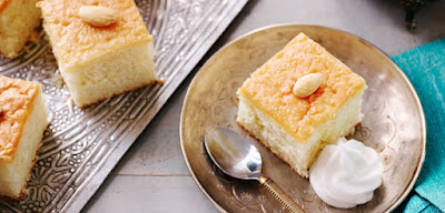 Almond and rose water combine perfectly in these light and fluffy Basbousa style cakes Almond and Rose Basbousa Style Cake Recipe