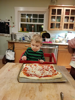 preschooler making pizza
