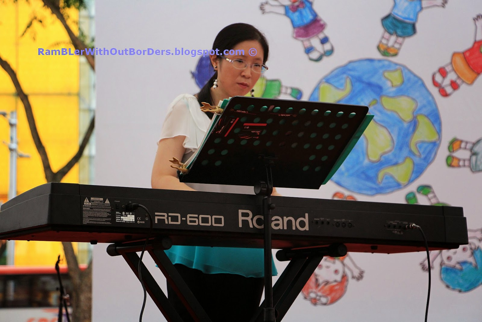 Piano player, Singapore International Red Cross Bazaar 2015