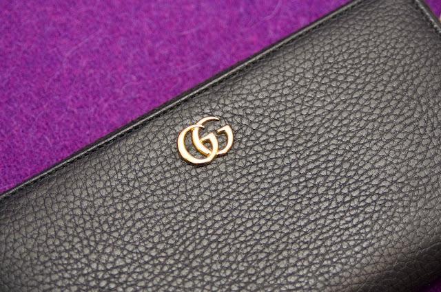 logo Gucci, dwie złote litery GG