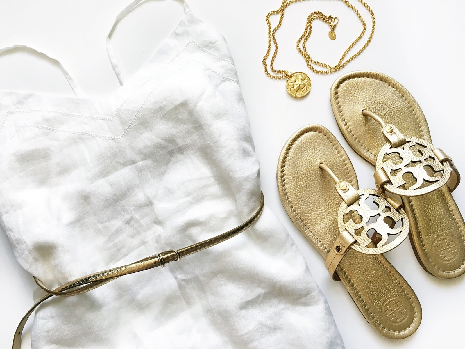 Fresh white linen dress paired with metallic gold sandals, belt and jewellery