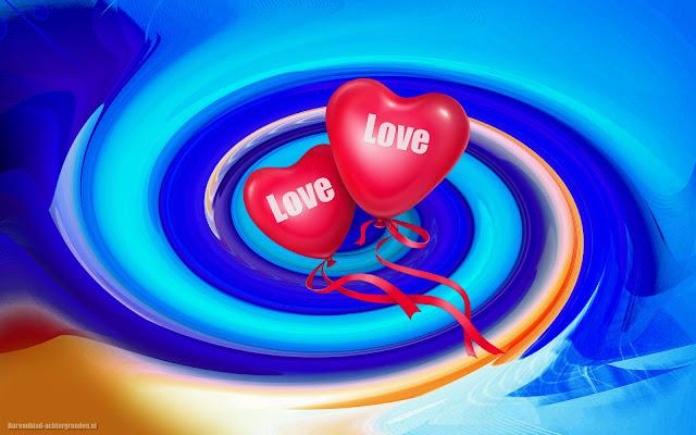 Twee rode ballonnen in de vorm van liefdes hartjes met de tekst love