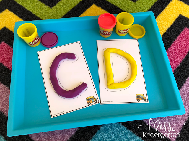 Forming letters with play-doh