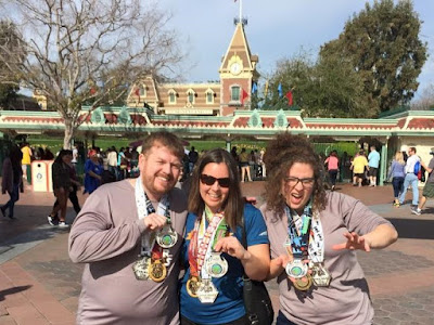 My husband, sister-in-law, and me posing with our runDisney Star Wars Rebel Challenge medals