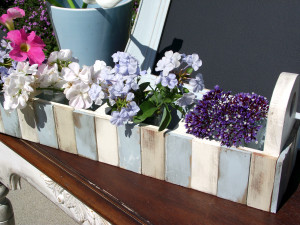 These re-purposed paint sticks make great flower boxes.