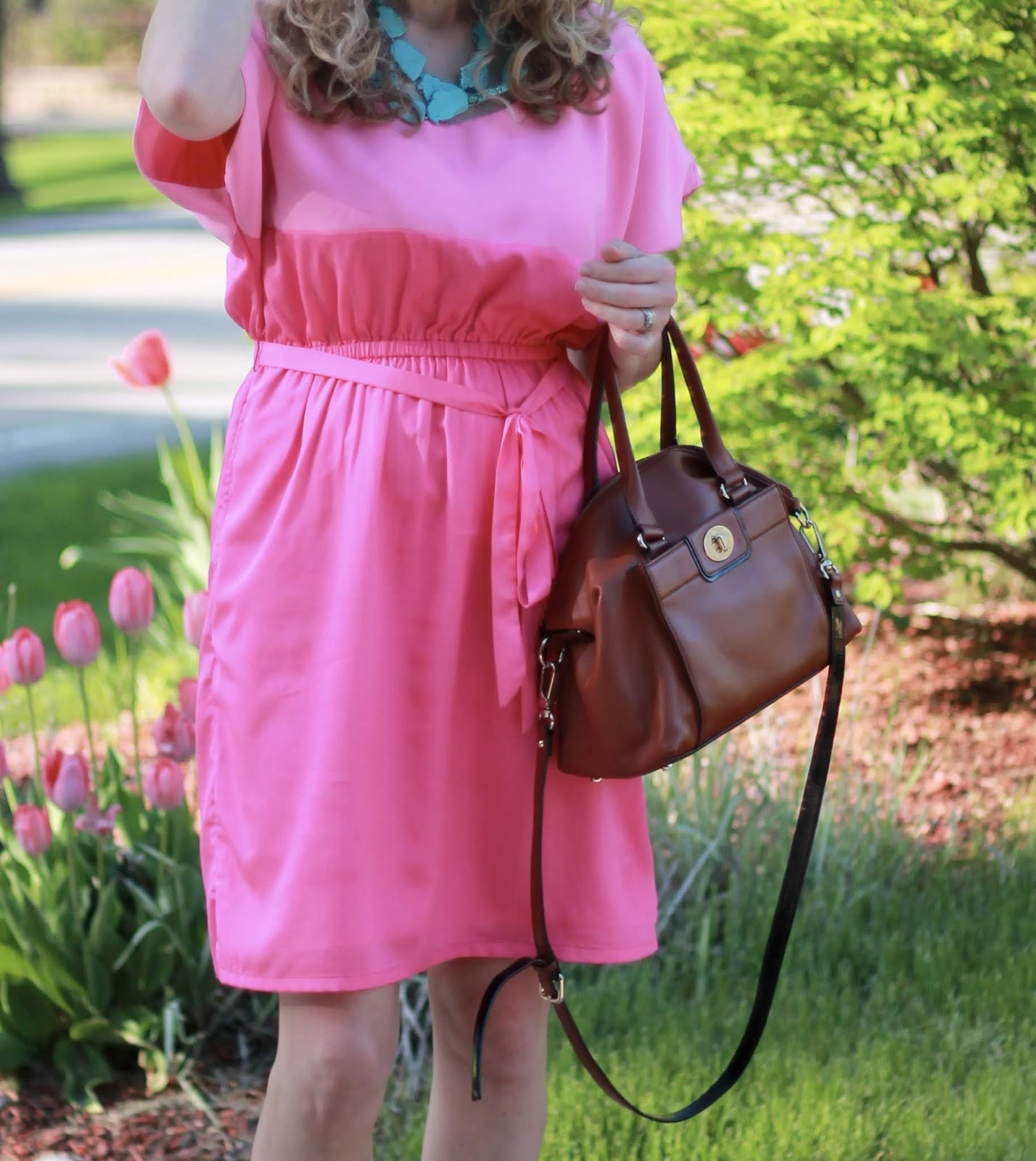 pink color block dress, turquoise necklace, wedges, cognac leather satchel