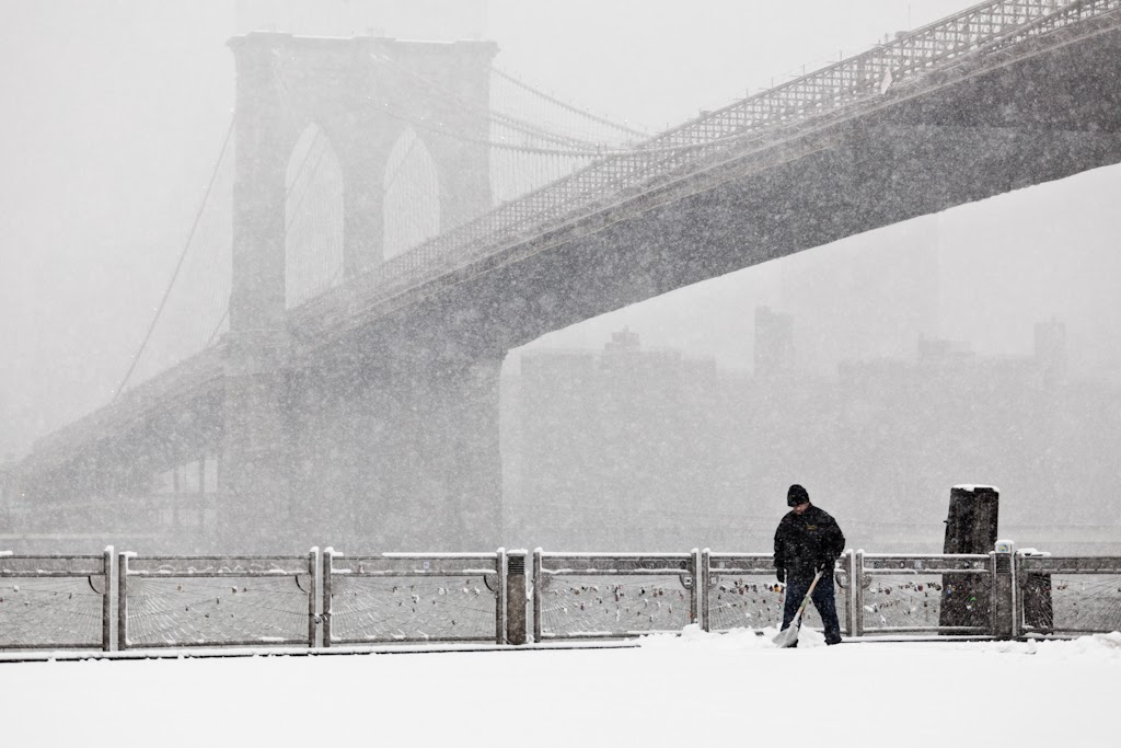 He has a long way to go, clearing the pier today of the accumulated snow will take a while, Dumbo, New York