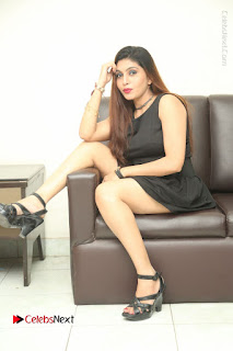 Tollywood Upcoming Actress Pooja Roshan Stills in Black Short Dress at Plus 1 Movie Trailer Launch  0337.JPG