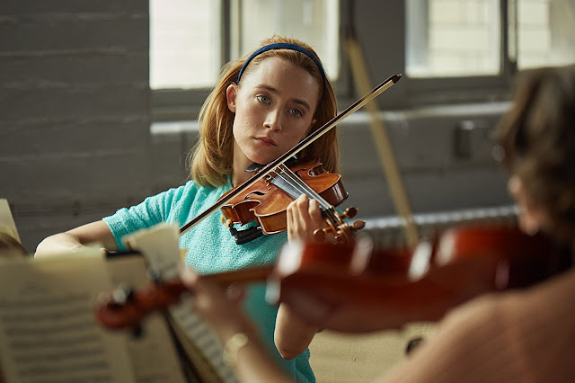 Saoirse Ronan playing violin as Florence in On Chesil Beach