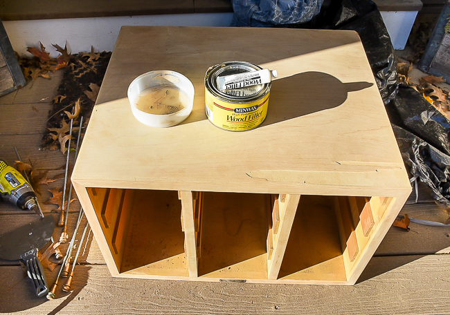 Repairing damage to card catalog with Minwax wood filler