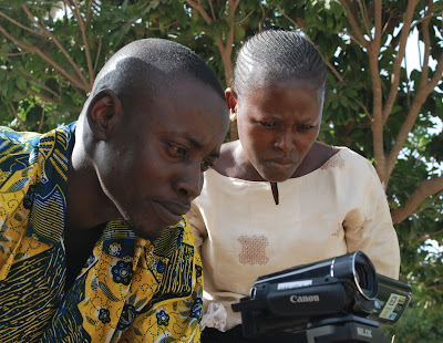 Lamin Fatty and fellow workshop participant, Khardiata Bodian, practice using the cameras at Tostan's training institute in Thiès, Senegal.