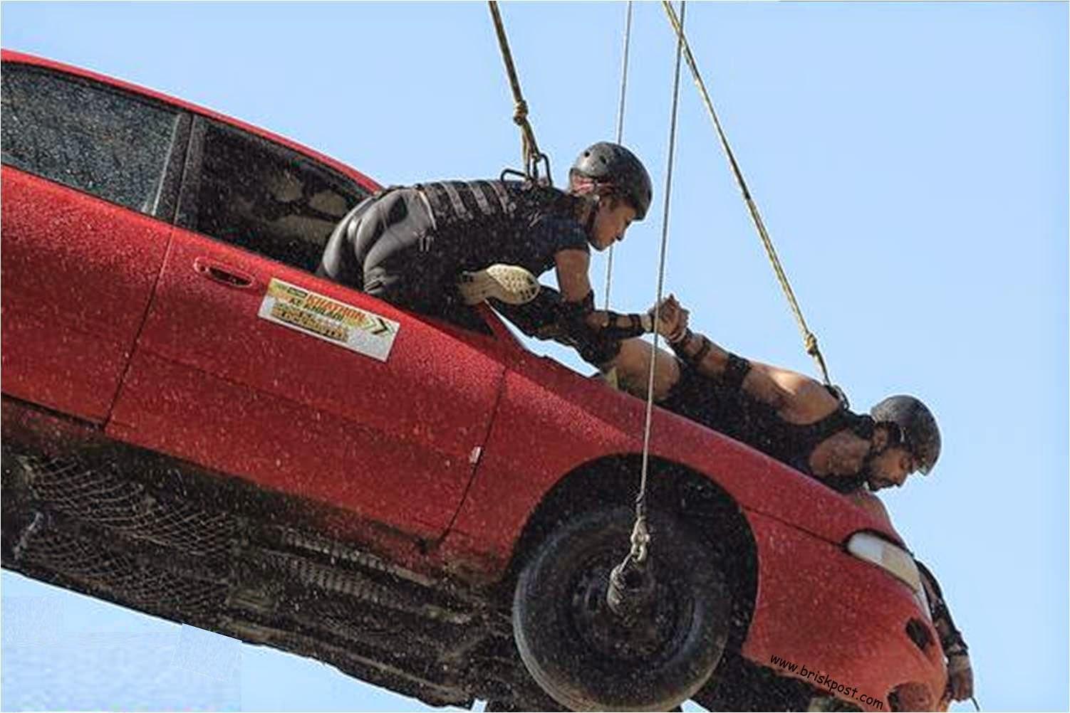 Fear Factor Khatron Ke Khiladi 5 Debina holding hand of Gurmeet while performing a height stunt on car in shower