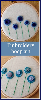 Embroidery hoop art with felt and button flowers