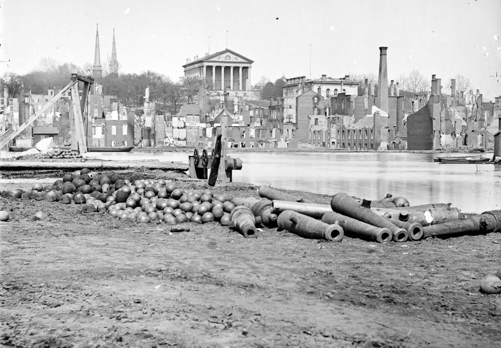 A view of the burned district of Richmond, Virginia, and the Capitol across the Canal Basin, in 1865. The city was assaulted by Union forces for more than nine months during the Siege of Petersburg, after which Confederate Gen. Robert E. Lee's army abandoned the battered city in April, 1865.