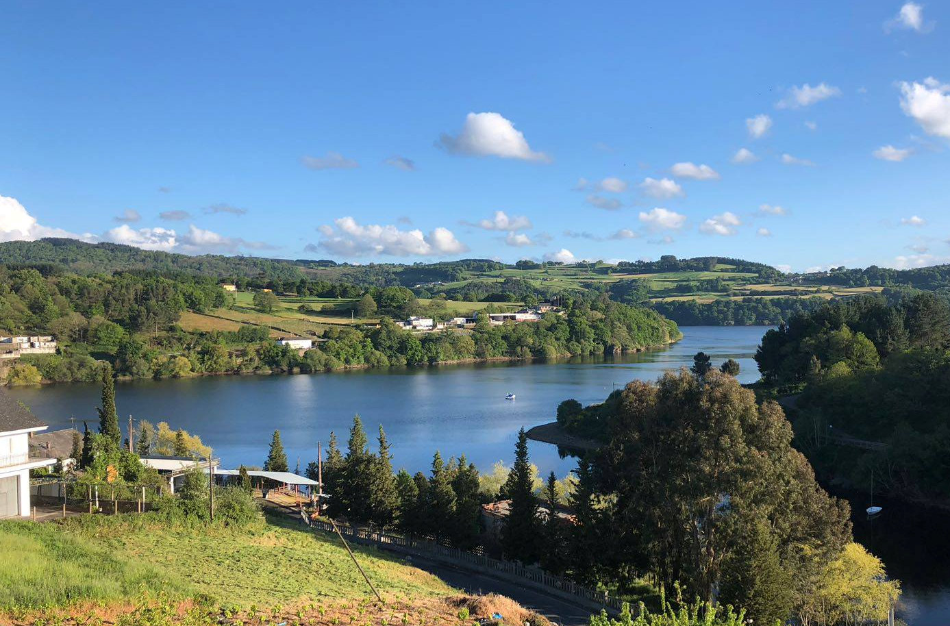 View of the Belesar Reservoir that now covers the original site of Portomarin. Photo: © Authentic Journeys.
