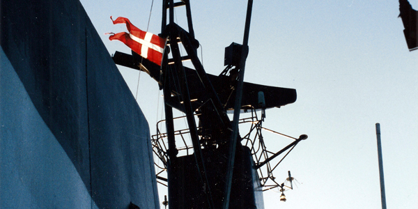 Dannebrog (Danish flag) waving in the wind on the corvette Peter Tordenskiold