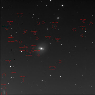 annotated photography with many faint galaxies identified