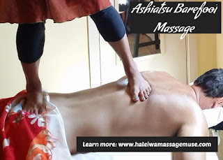 man laying face down receives ashiatsu barefoot massage in Haleiwa, Hawaii
