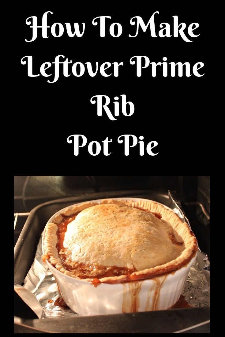 leftover prime rib pot pie cooling in a white casserole dish dripping the gravy over the sides