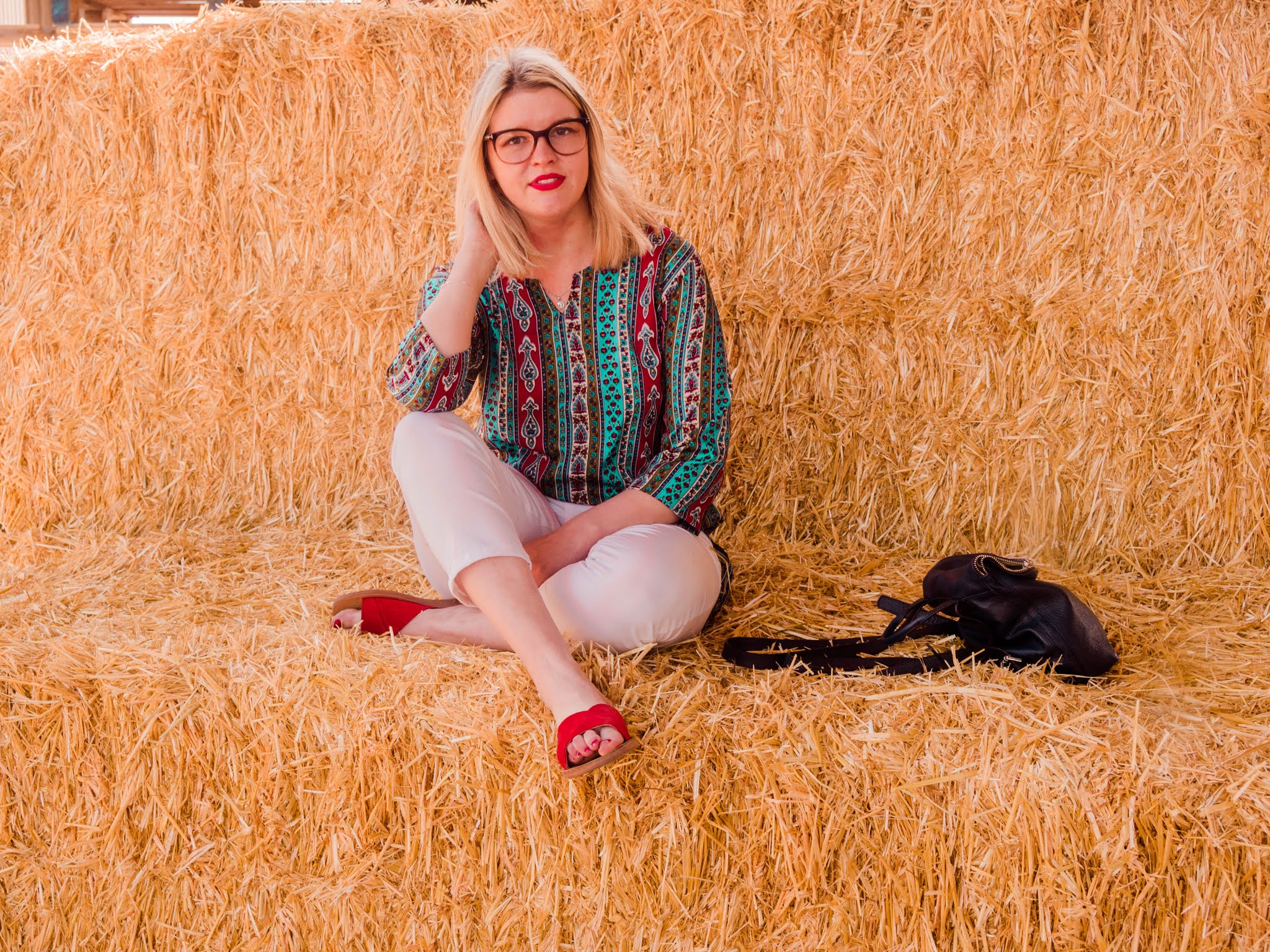 Fashion Blogger Chloe Harriets - on haystack wearing colour printed tee bought in India - New Habits Blog Post
