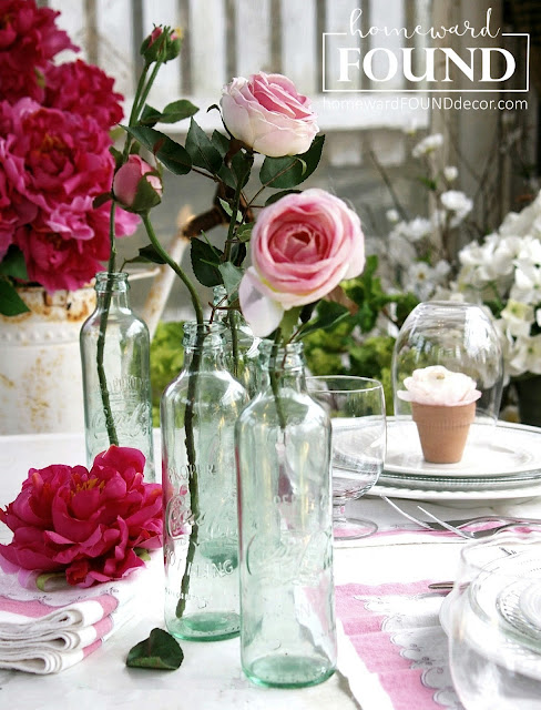 pink vintage spring tablescape in a gardenhouse from homewardFOUNDdecor.com