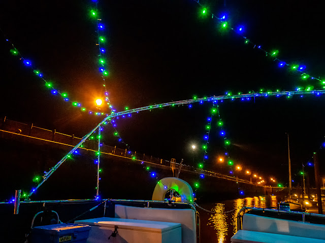 Photo of lights across Ravensdale's bimini frame and across her aft deck