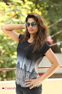 Actress Karuna Pictures in Jeans at Tholi Kiranam Press Meet 0012