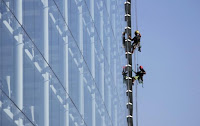 Employees clean the windows of the main building of the European Parliament in Strasbourg, September 21, 2006. (Credit: Reuters/Vincent Kessler) Click to Enlarge.