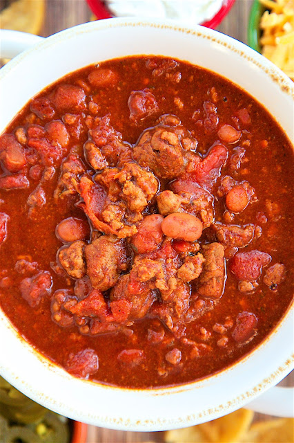 Slow Cooker Ranch Chili - THE ULTIMATE chili recipe!! Ground beef, stew meat, diced tomatoes, Rotel tomatoes, chili beans, beef broth, tomato paste, chili powder, cumin, garlic and Ranch dressing mix. This has all the best from all of my chili recipes. It is the BEST chili recipe! Great for a crowd! Serve with some cornbread for a quick and easy meal!