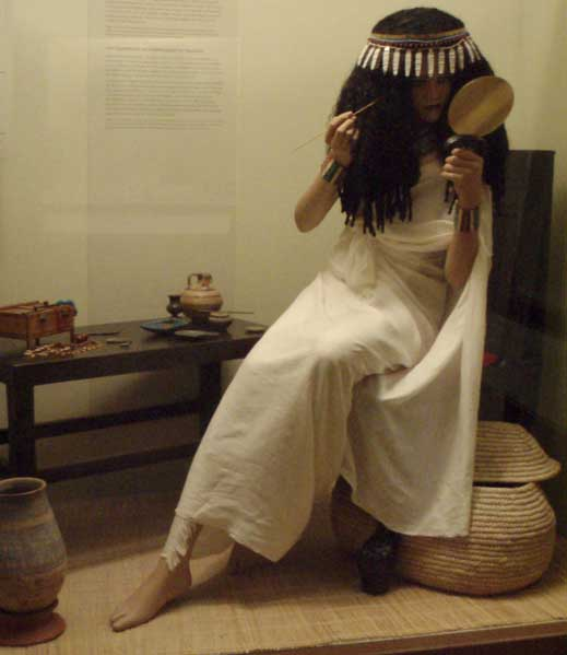 ancient Egyptian woman applying cosmetics