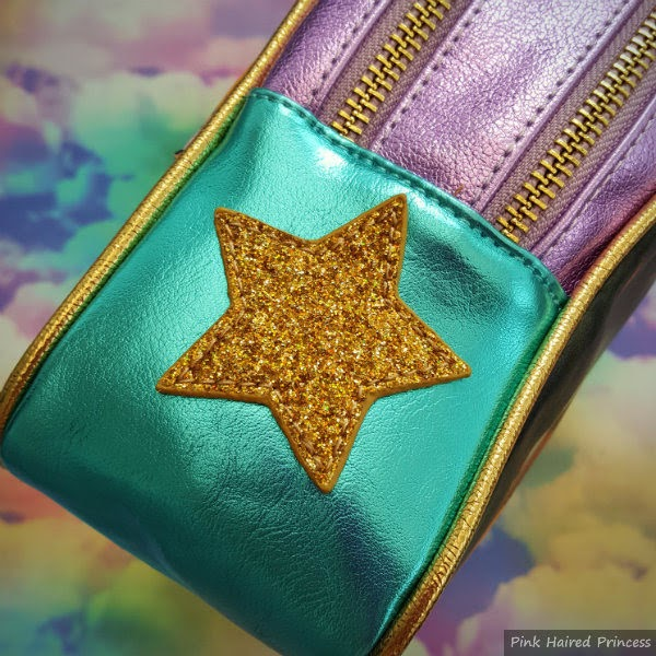 large gold glitter star on side of turquoise metallic handbag