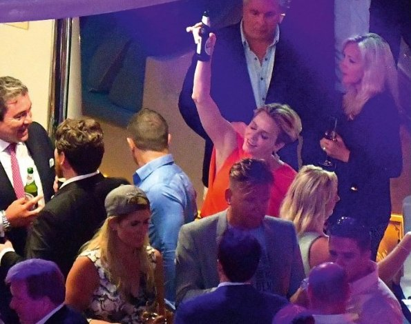 the 74th Formula Grand Prix races held in Monaco. Princess Charlene's happily dancing, drink beer