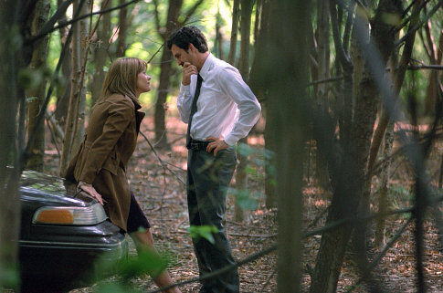 Meg Ryan and Mark Ruffalo are trying to hide in the forest from the camera crew. They did not succeed.