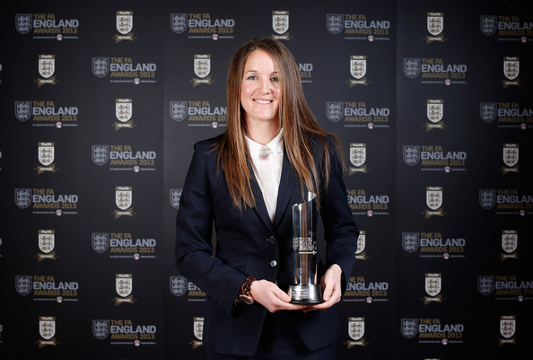 Casey Stoney poses with the 2013 Club England Team of the Year award