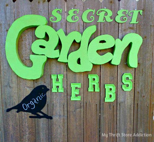 Signs of Spring at Secret Garden Herbs mythriftstoreaddiction.blogspot.com  Secret Garden Herbs sign created with an assortment of thrifted letters!
