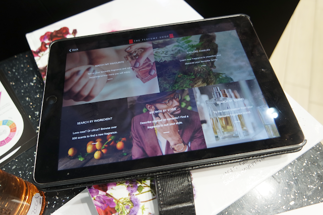 tablet with The Perfume Shop app loaded on screen