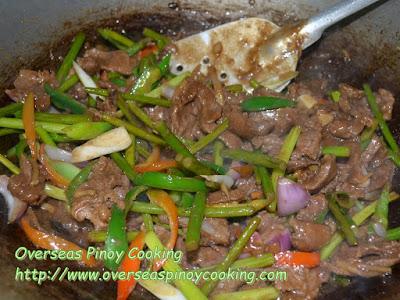 Beef with Garlic Stem Stirfry Cooking Procedure