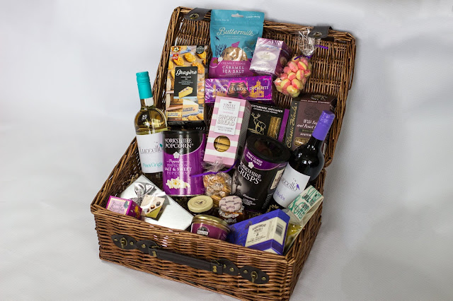 An open luxury wicker hamper from Prestige Hampers with all the contents displayed