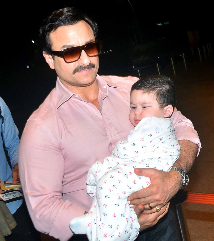 Kareena kapoor, Saif Ali Khan with son Taimur at Mumbai Airport