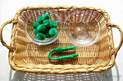 Tweezing Green Pom Poms