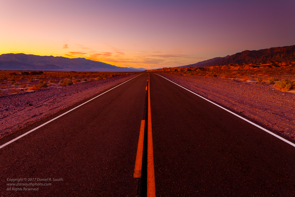 a photo of a desert highway at dusk in death valley